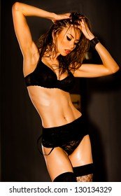 hot woman in lingerie with sexy body posing glamorous in the studio
