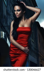 hot woman in red dress in the night town