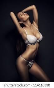 hot woman in white lingerie in dark