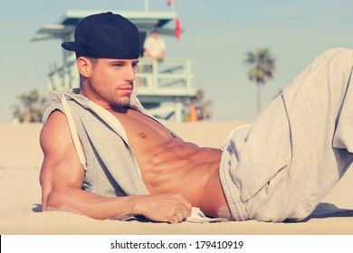 Hot young guy at the beach with very subtle retro toning