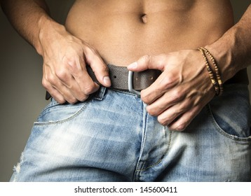 Hot young man wearing jeans
