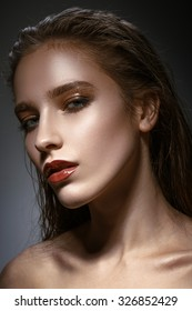 Hot young woman model with sexy bright red lips makeup, strong eyebrows, clean shiny skin. Beautiful fashion portrait of glamour female face.