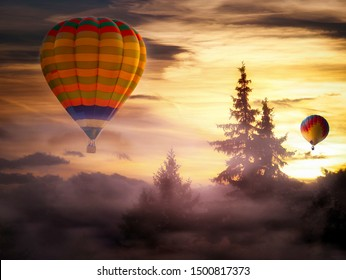 Hot-air balloon ride at sunrise in a fairytale-like landscape with wafts of fog