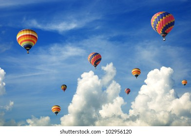 Hot-air balloons in the cloudy blue sky