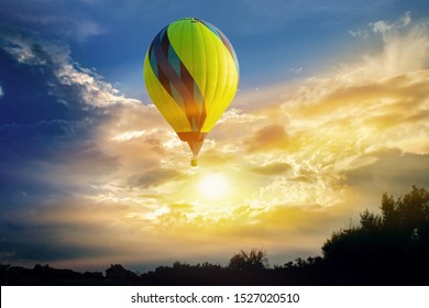 Hot-air balloons in sky . Hot air balloons flies in blue sky . A journey at dawn of the sun. Start in the morning