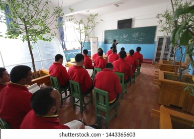 HOTAN, CHINA - APRIL 27 2019. Uighurs learn gardening at reeducation camp (vocational skills training center) in Moyu County, Hotan Prefecture in Xinjiang.