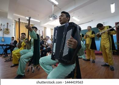 HOTAN, CHINA - APRIL 27 2019. Uighur folk ensemble plays a musical program at reeducation camp (vocational skills training center) in Moyu County, Hotan Prefecture in Xinjiang.