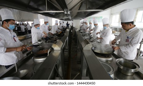 HOTAN, CHINA - APRIL 27 2019. Uighur students cook food for 1000 people at reeducation camp (vocational skills training center) in Moyu County, Hotan Prefecture in Xinjiang.