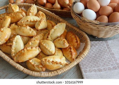 Hotcakes are homemade, fresh eggs,  onions and napkin on a wooden table.