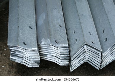 Hot-dip galvanized steel angles bunch on the rack in warehouse before shipment