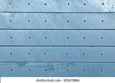 Hot-dip galvanized steel angles bunch on the rack in warehouse
