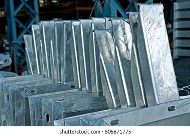 Hot-dip galvanized steel members bunch on the rack in warehouse
