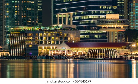 Hotel alongside the main river in Singapore at night time with crowded in the restaurant. October 24, 2016
