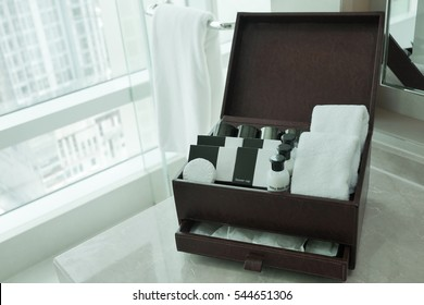 Hotel amenities kit in brown leather box