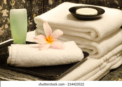Hotel Amenities (Towels,shower bath and soap) with frangipani : Actual photography in hotel environment