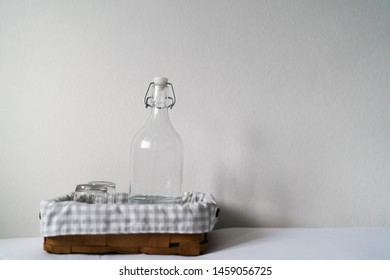 Hotel basic accommodation. Include, glass of bottle, glass of water orderly in the wooden tray.