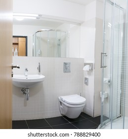 Hotel bathroom in a four-star apartment. Shower, toilet, wash basin with large mirror and hairdryer. - Shutterstock ID 788829400