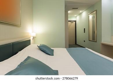 Hotel bedroom i the evening