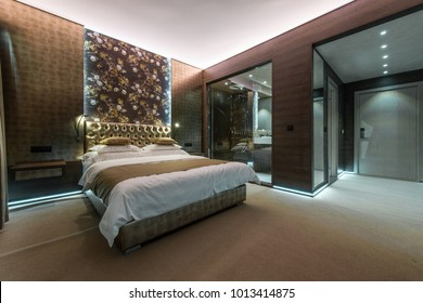 Hotel bedroom interior with private bathroom