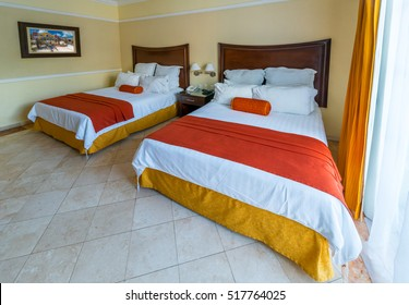 Hotel bedroom in traditional tropical, caribbean style. Interior design.