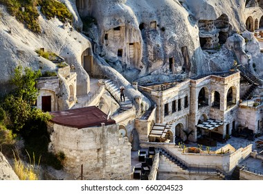 Hotel boutique in the Tufa Mountains at sunset in Goreme city, Cappadocia, Turkey
