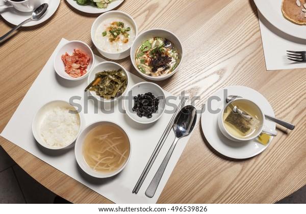 The hotel buffet breakfast food, salad, bread, egg, cornflake, coffee, han-food on the wood table in seoul, south korea.