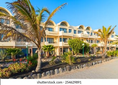 Hotel building along coastal promenade in Playa Blanca village, Lanzarote, Canary Islands, Spain