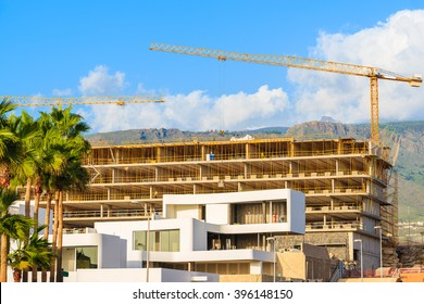 Hotel buildings under construction in Costa Adeje town on tropical Tenerife island, Spain