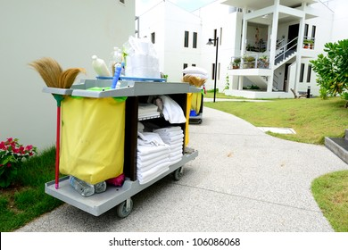 The hotel cleaning tool cart of housekeeper are on the walkway of resort area