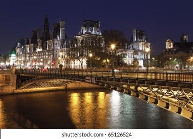 Hotel de Ville (City Hall of Paris)  and bridge D'Arcole across Seine river at night, Paris, France