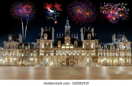 The Hotel de Ville in Paris, France, is the building housing the city's local administration. Night view in front with no people and fireworks in the sky.