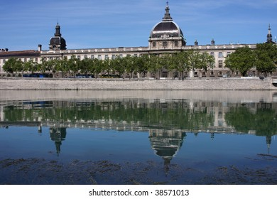Hotel Dieu reflecting on the waters of Rhone River