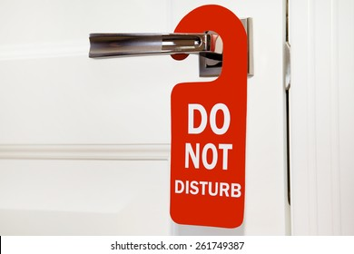 Hotel do not disturb red sign on white door