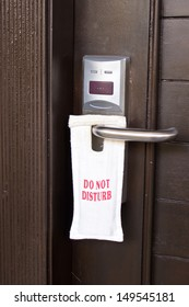 Hotel door with sign do not disturb