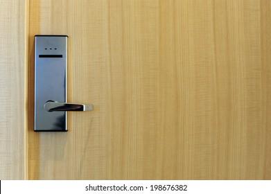Hotel electronic lock on wooden door