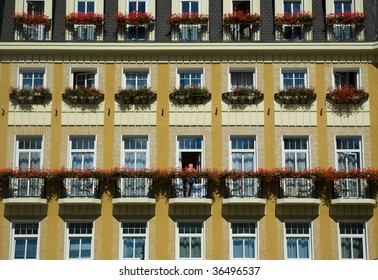 Hotel facade in Karlovy Vary with man on balcony