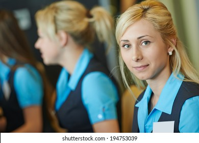 hotel female receptionist or support help desk worker