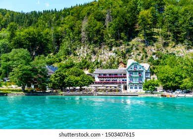 Hotel Furberg on Wolfgangsee lake by in St Sankt Gilgen with alps mountains, boats, Sailboats. Salzkammergut, Salzburg, Austria