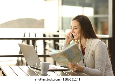 Hotel guest holding a map planning vacation asking information on phone