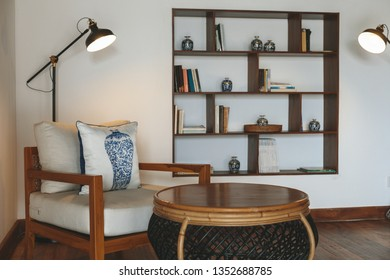 Hotel hall room with lamp, books and armchair
