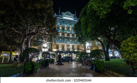 Hotel Hermitage in Monte Carlo illuminated by night timelapse hyperlapse, Monaco. Park in front of it. This historic luxury hotel was built in the early 1900s in the heart of Monte-Carlo.