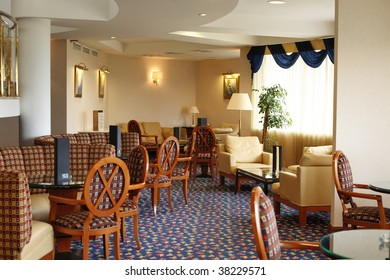 Hotel lobby. Chairs and tables in front of window