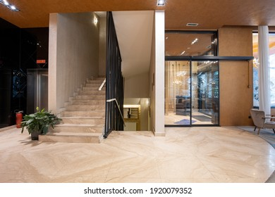 Hotel lobby interior with marble floor and stairs