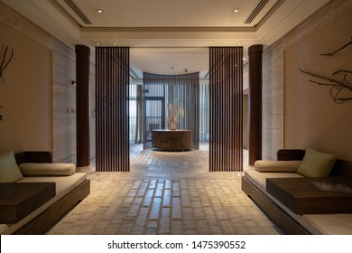 Hotel lobby interior with reception desk, sofas, zen spa and Chinese style.