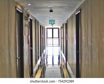 Hotel luxury interior design. View of an empty corridor with doors.