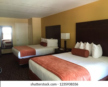 Hotel / Motel room with two queen beds