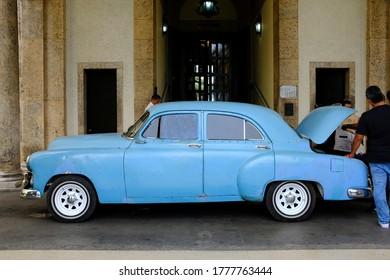 Hotel Nacional de Cuba, Havana, Cuba - October 2019 : A classic American car used as a taxi parking at the entrance to Hotel Nacional de Cuba.