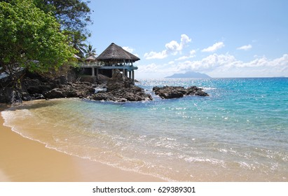 Hotel on a wild beach in Seychelles, sunny day on a tropical wild beach
