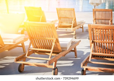 Hotel Poolside Chairs with Sunlight. Horizontal filtered shot