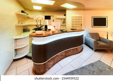 Hotel reception with Table desk on light background. Empty architecture with room interior. Luxury lifestyle. Contemporary great design for any purposes. Business meeting concept. Corporate Holiday